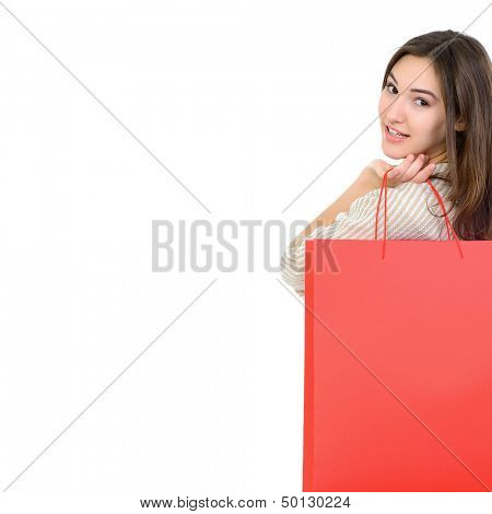 beautiful happy girl shopaholic with red shopping bags, over white
