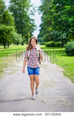 Beautiful Teenager Girl In Casual Clothes Going To School On Sunny September Day, Outdoor Portrait