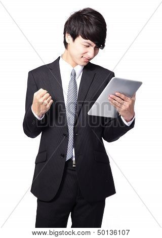 Asian Businessman Using Touch Pad With Annoyed .face