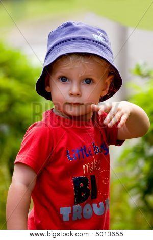 Little Boy Striking A Pose