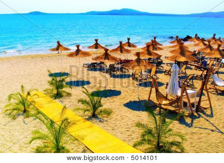 Straw Umbrellas On Beautiful Sunny Beach