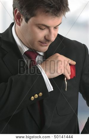 Man Businessman Holding Credit Card Or Other Plastic Card