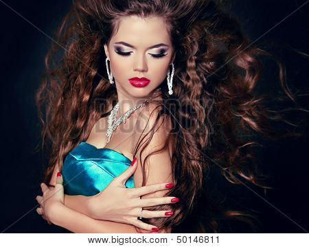 Beautiful Woman With Long Brown Blowing Hair. Fashion Girl With Jewelry.