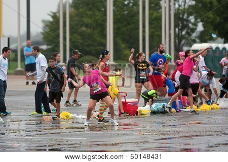 People Take Part In Huge Group Water Balloon Fight