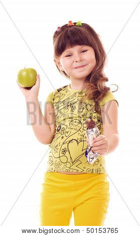 Beautiful little girl with apple on white background