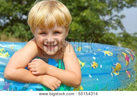 Happy Child In Baby Pool