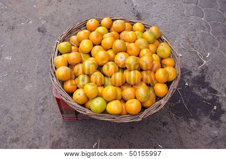 Tangerine Fruit In Woden Wicked Basket In Delhi Market, India