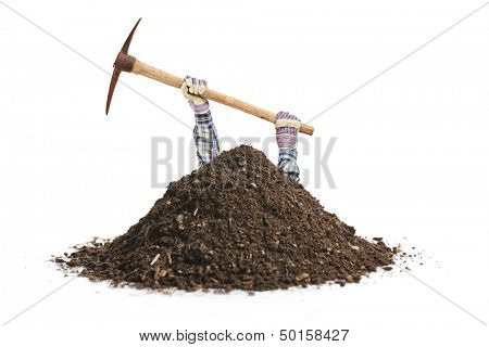 Male manual worker digging a hole isolated on white background