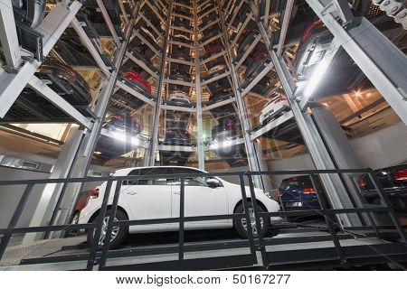 MOSCOW - JAN 11: Bottom view of the Volkswagen Golf on parking lot with a multi-story automated car parking system in Volkswagen Center Varshavka at night on January 11, 2013, Moscow, Russia