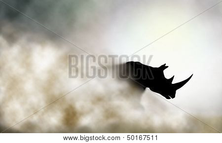 Illustration of a charging rhinoceros and dust cloud