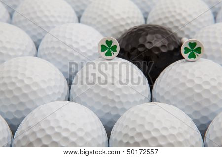 White And Black Golf Balls And Wooden Tees