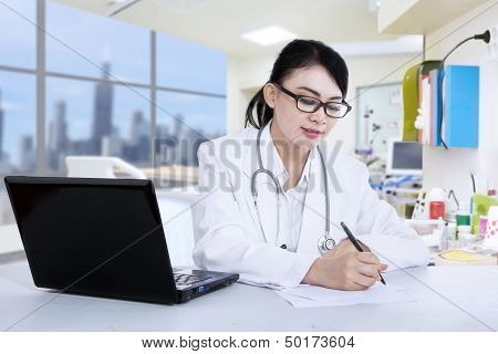 Beautiful Doctor Write Prescription At Clinic