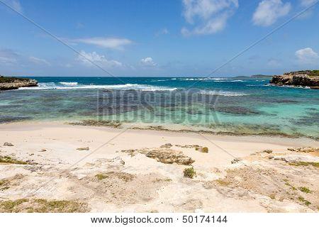 Beautiful Rustic Caribbean Sandy Bay And Sea
