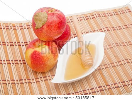 Pyramid Of Red Apples And Honey In Gravy Boat