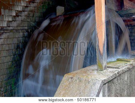 watermill  - motion blur on wooden wheel