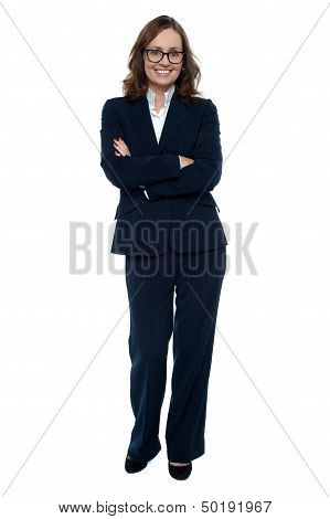 Executive In Business Attire Standing Arms Folded