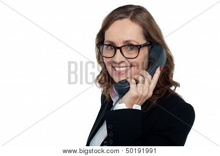 Bespectacled Woman Talking Over The Phone