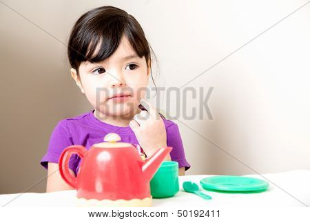 Young Girl Thinking Over Tea