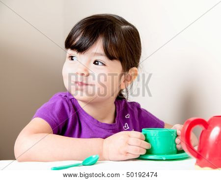 Happy Girl With Mouth Full Of Tea