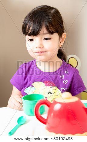 Toddler Thinking At Tea Time