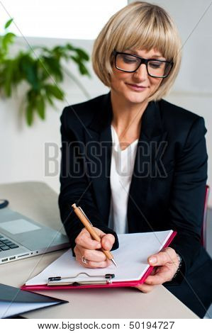 Secretary Jotting Down Notes And Instructions