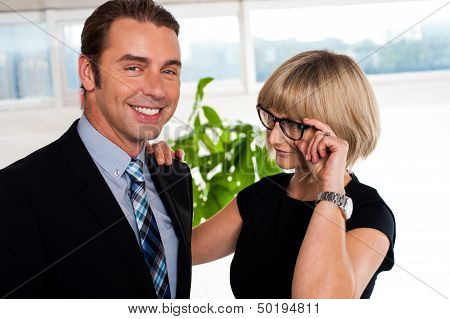 Secretary Watching Her Boss Closely While Adjusting Her Glasses