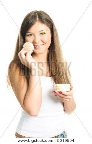 Woman Applying Powder With A Sponge