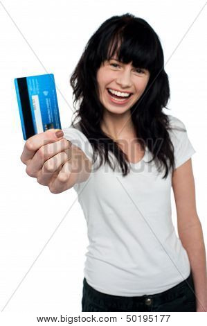 Joyous Brunette Showing Her Credit Card To You