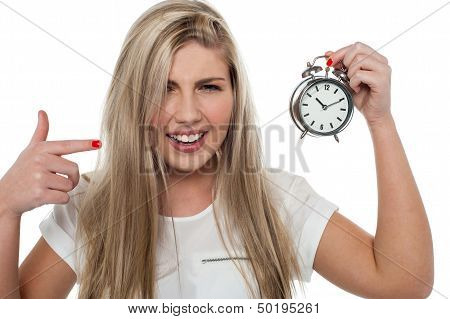Girl Pointing Towards Old Fashioned Time Piece