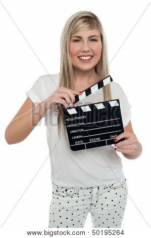 Cheerful Teen Girl With Clapboard In Hand