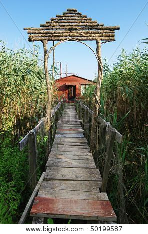 boardwalk to red wooden shack for fishing on the Ada Bojana river, Montenegro