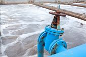 image of groundwater  - Industrial tap with blue pipeline for oxygen blowing into sewage water - JPG