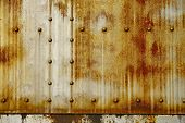 picture of nasty  - Rusty Metal with Rivets Photo Background - JPG