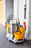 stock photo of janitor  - Bathroom cleaning kit include any cleaning product on small car - JPG