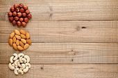 Filberts, Almonds And Cashew Nuts On Wooden Background