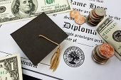 foto of tassels  - College or high school diploma with mini mortar board and money