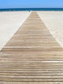 foto of summer beach  - wooden footbridge at the beach - JPG