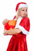 image of greedy  - Greedy Christmas woman holding present isolated on white background - JPG