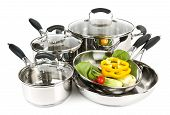 foto of dutch oven  - Stainless steel pots and pans isolated on white background with vegetables - JPG