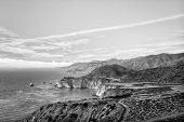stock photo of bixby  - Historic Bixby Bridge Along California Central Coast in Black and White - JPG