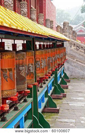 Row Of Tibetan Prayer-wheels In Chengde, China