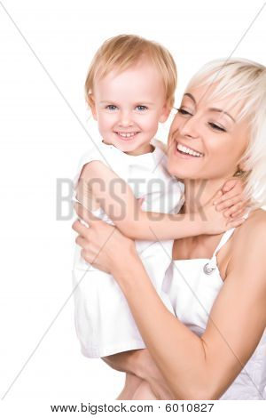 Happy Attractive Mother With Her Smiling Daughter