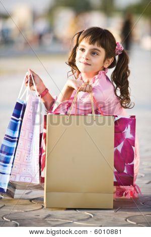 Smiling Girl Holding Shopping Bags