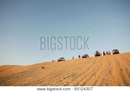 Tourists In Sahara Desert