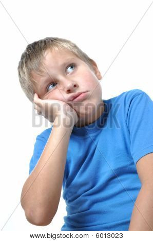 Portrait Of Young Boy Sitting Isolated