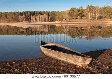 Old Boat On The River Bank