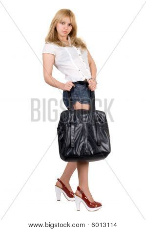 Beautiful Girl With A Black Handbag. Isolated