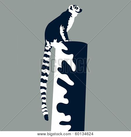 An image of a lemur perched on a post.
