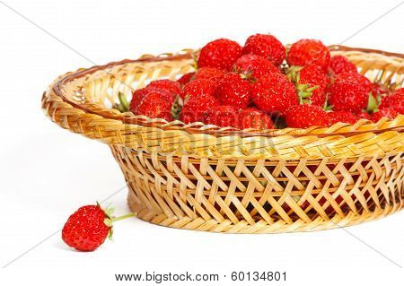 Many Strawberries In A Basket And One Berry