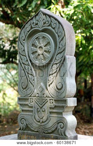 Stone boundary marker, symbolic of Buddhism
